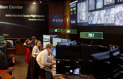 Workers monitor research operations aboard the International Space Station from NASA\'s Payload Operations Integration Center in Huntsville, Alabama, on Jan. 9, 2019. Of the roughly 800,000 federal employees affected by the shutdown, more than half are deemed essential, and are working without pay.