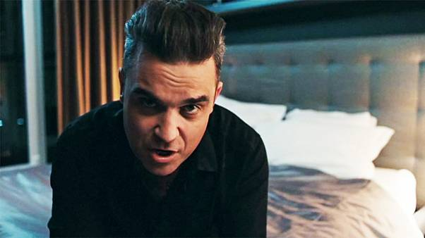 "Novo videoclipe de Robbie Williams: ""Mixed Signals"""
