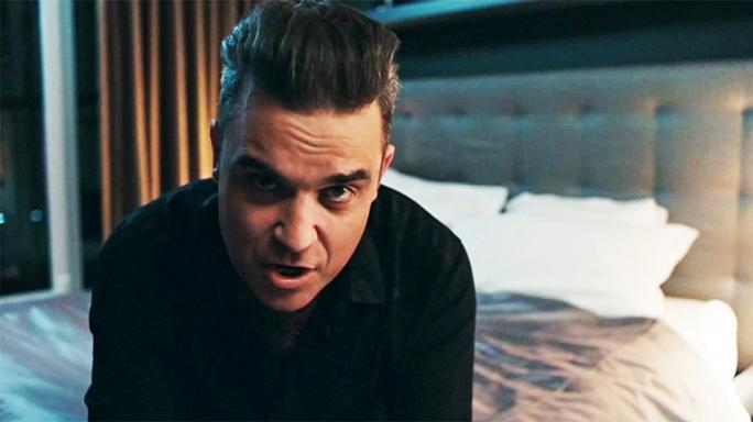 "Novo videoclipe de Robbie Williams: ""Mixed Signals"""