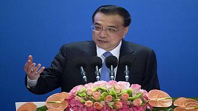 China trims GDP target, citing severe challenges