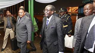 'Upbeat and jovial' Mugabe returns from Singapore after medical review