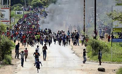 Protesters take to the streets of Harare, Zimbabwe, on Monday.