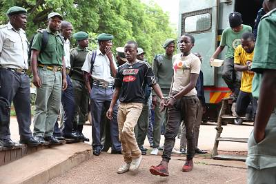 Protesters arrive at a court in Harare, Zimbabwe, on Thursday.