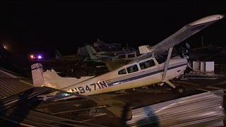 Plane flipped over after storm hits airport
