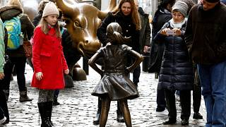 On International Women's Day, a bronzed girl defies Wall Street bull