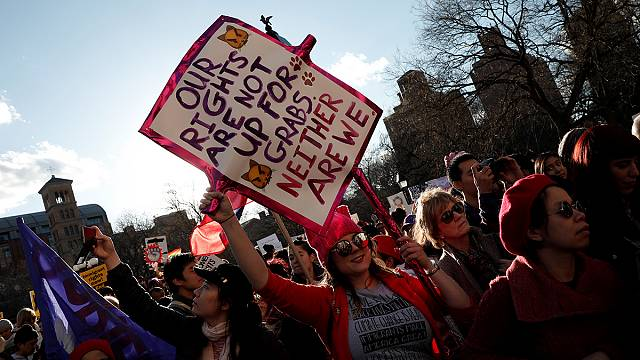 Women's Day marchers target Trump on abortion and pay gap
