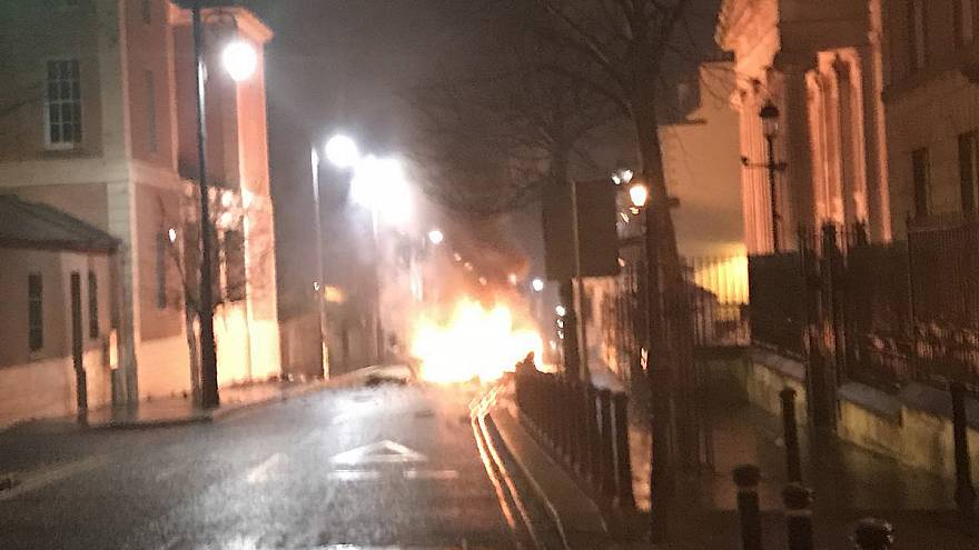 A suspected car bomb in front of a courthouse in Derry, Northern Ireland on