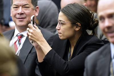 Rep.-elect Alexandria Ocasio-Cortez, D-N.Y., takes a photo as she attends the Member-elect room lottery draw on Capitol Hill in Washington on  Nov. 30, 2018.
