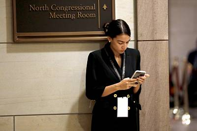 Incoming Representative Alexandria Ocasio-Cortez waits for a House of Representatives member-elect welcome briefing on Capitol Hill on Nov. 15, 2018.