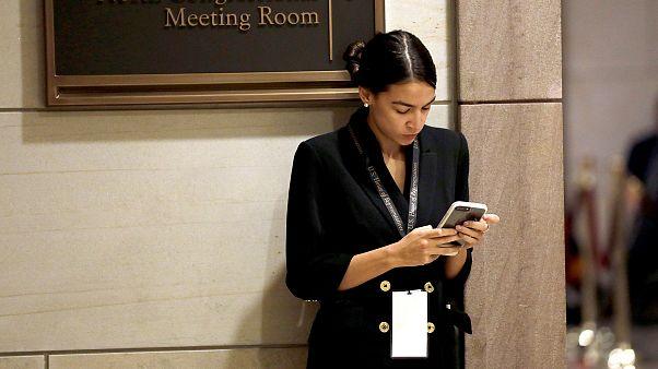 Incoming Representative Alexandria Ocasio-Cortez waits for a House of Repre
