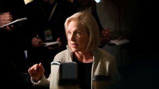 Image: FILE PHOTO: U.S. Senator Kirsten Gillibrand (D-NY) talks to customer