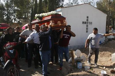 People at a funeral on Sunday for a person who died in a gas pipeline explosion Friday night in the village of Tlahuelilpan, Mexico.