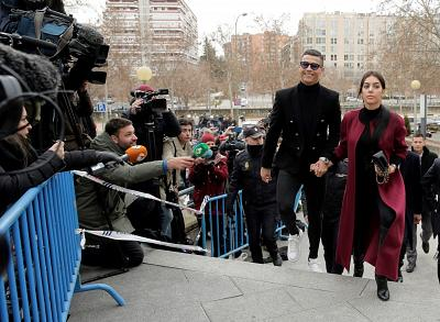 Soccer star Cristiano Ronaldo and his partner Georgina Rodriguez arrive at a court in Madrid, Spain, on Tuesday.