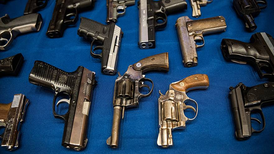 Image: Guns seized by the New York Police Department at a press conference