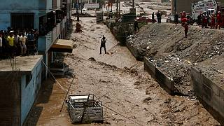 Residents saved from muddy torrents in Peru floods