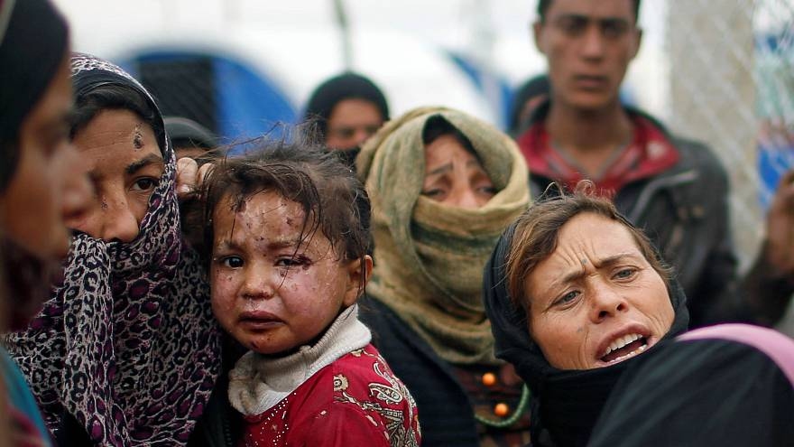 As life returns to eastern Mosul, people flee raging battle in west