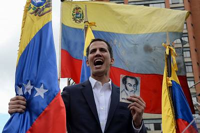 "Venezuela\'s National Assembly head Juan Guaido declares himself the country\'s ""acting president"" during a mass opposition rally on Wednesday."
