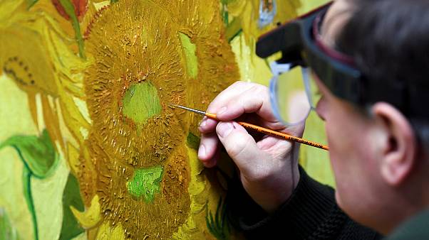 Image: Renovator Rene Boitelle works on a restoration of Van Gogh's paintin