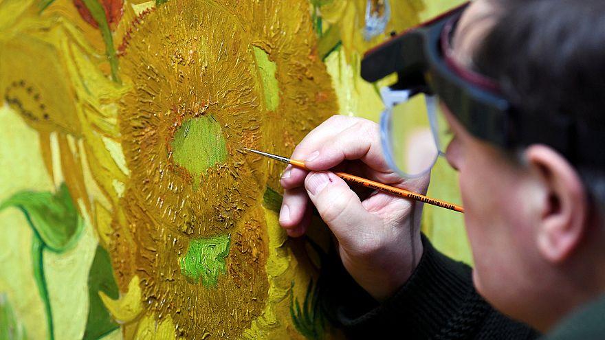 Image: Renovator Rene Boitelle works on a restoration of Van Gogh's paintin