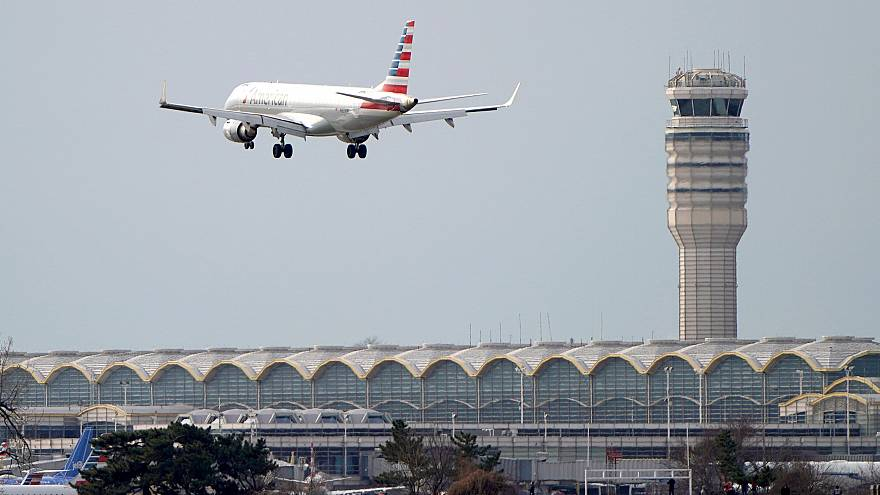 Image: An airplane and air traffic control tower on the 22nd day of the par