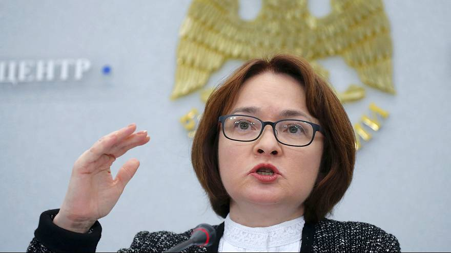Russian central bank confounds forecasts with interest rate cut