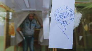Bulgarians vote in close parliamentary poll