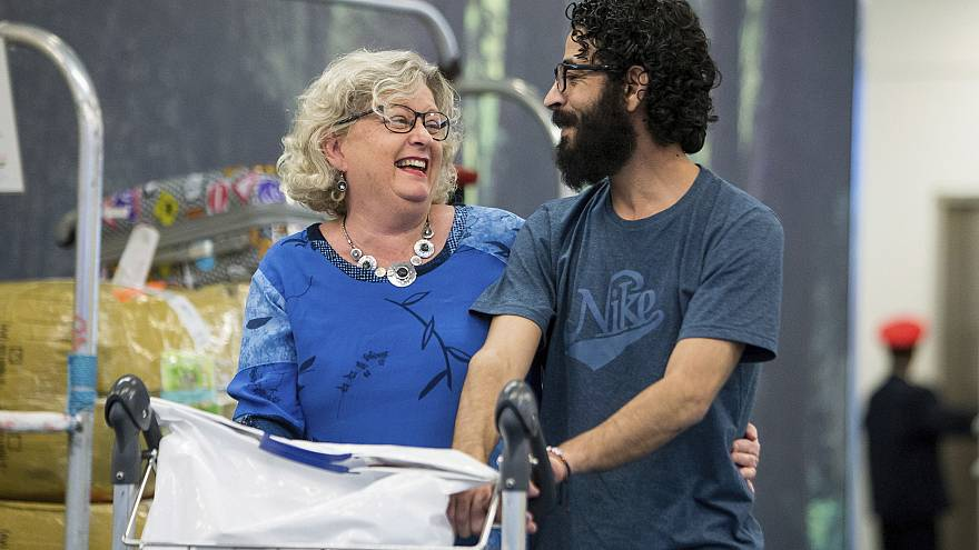 Image: Laurie Cooper and Hassan Al Kontar after he arrived in Vancouver