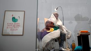 French performance artist attempts egg hatching