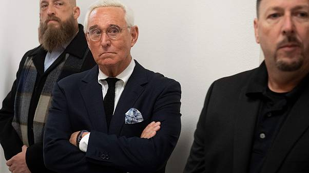 Image: Political Strategist Roger Stone stands outside the hearing room pri