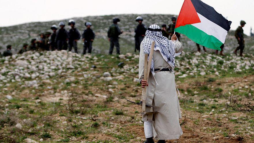 Столкновения палестинских активистов с израильскими силами безопасности в «День земли»