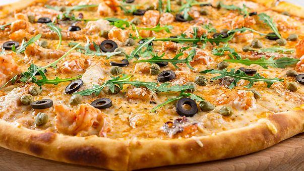 Danish minister's call to report illegal pizza bakers leaves bitter taste