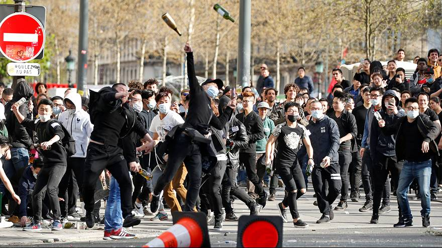 Family of Chinese man shot dead by French police calls for calm