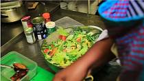 Nigerian born chef in London preparing vegan dishes