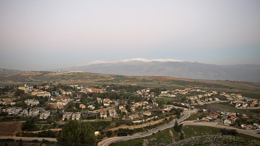 Image: The town of Metula with Mt. Hermon in the background