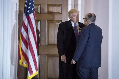 Then President-elect Donald Trump talks with Rudy Giuliani after a meeting at the clubhouse at Trump National Golf Club Bedminster in New Jersey, on Nov. 20, 2016.