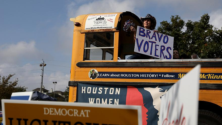 Image: A woman shows support for voters outside the Metropolitan Multi-Serv