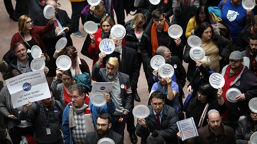 Furloughed federal workers and those aligned with them protest the partial