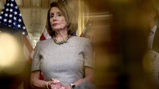 Image: Speaker of the House Nancy Pelosi listens to reporters on Capitol Hi