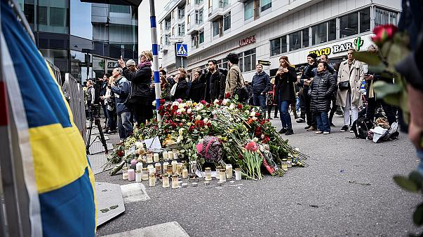 Sweden mourns as police say 'device' was found in killer truck