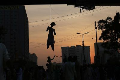 An effigy of Aasia Bibi is displayed during a rally in Karachi, Pakistan, in November as radical Islamists protested the Supreme Court\'s decision to overturn the Christian woman\'s death sentence.