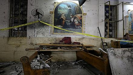 Egypt: We take a look at Sunday's bomb blast outside a Coptic church in Alexandria [no comment]