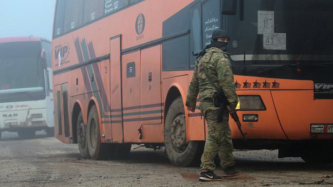Evacuation begins of four besieged towns in Syria