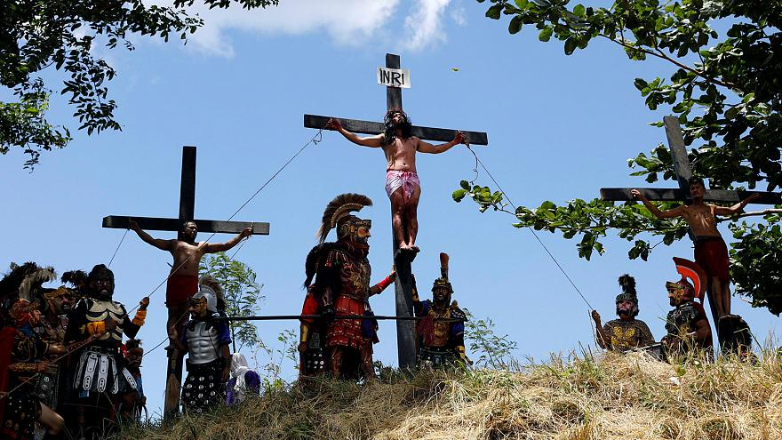 Filipino Catholics crucify themselves in a biblical reenactment