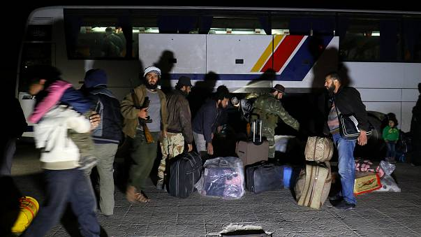 Syria evacuees arrive in shelter near Aleppo