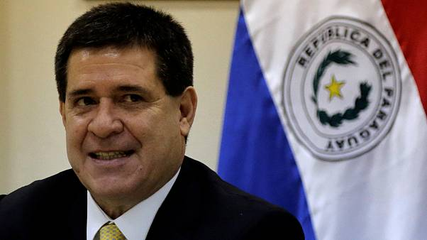 Paraguay's President Horacio Cartes decides not to run for second term following bloody protests