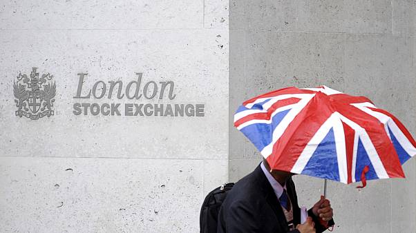 UK shares fall, pound jumps on surprise election announcement