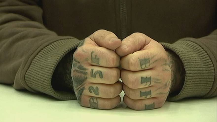 German politician loses appeal against jail term for 'Holocaust' tattoo