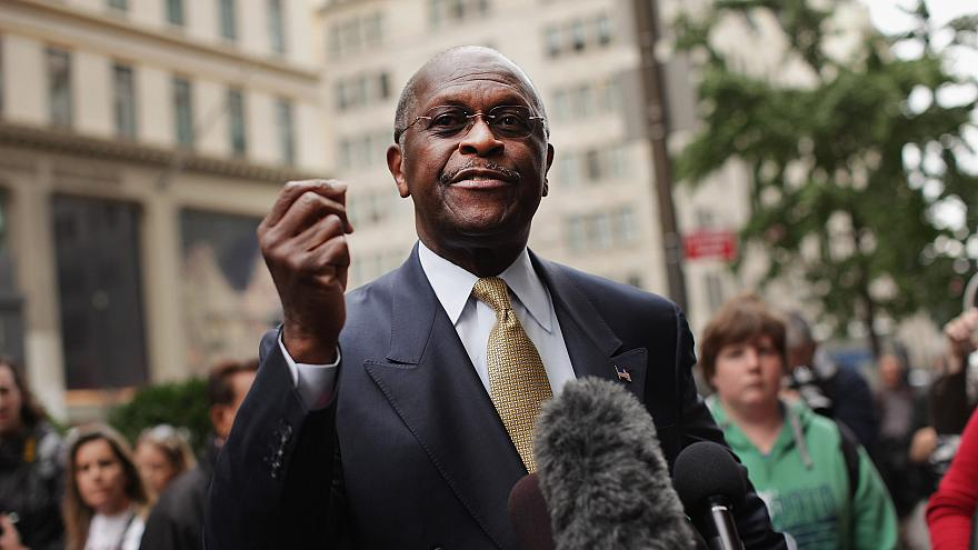 Image: Herman Cain speaks to the media outside Trump Tower before a meeting