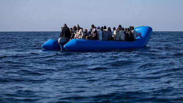 Image: An inflatable boat with 47 migrants on board is rescued by the Dutch