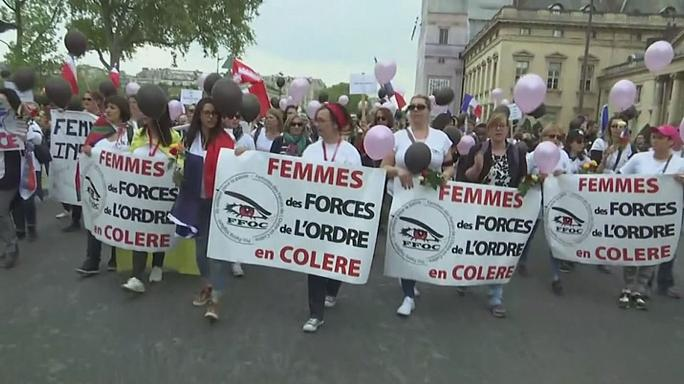 Wives march through Paris in anger over shooting of policeman